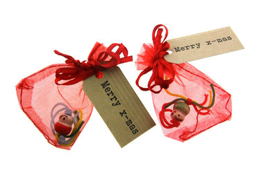 Kerst gelukszakje chinees gelukspoppetje en kraft label