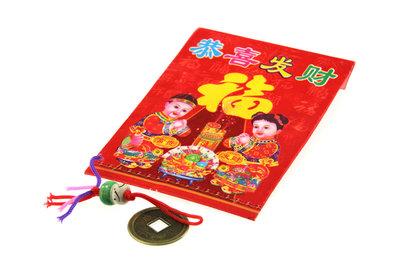 Gelukszakje Chinees geldzakje met gelukspoppetje en geluksmunt