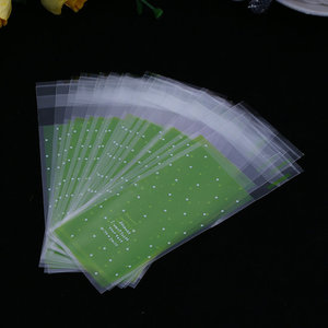 Cellofaan zakjes groen met witte stipjes 5 x 13 cm 10 stuks